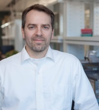 Troy Runge posing in his lab