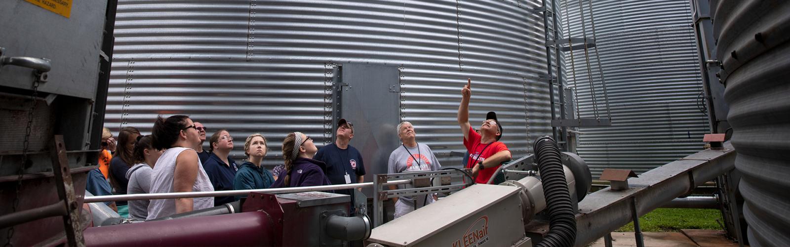 Jeff Nelson leading a group through grain bins at the Arlington ARS EMT training